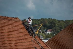 A roofer doing a residential roof repair