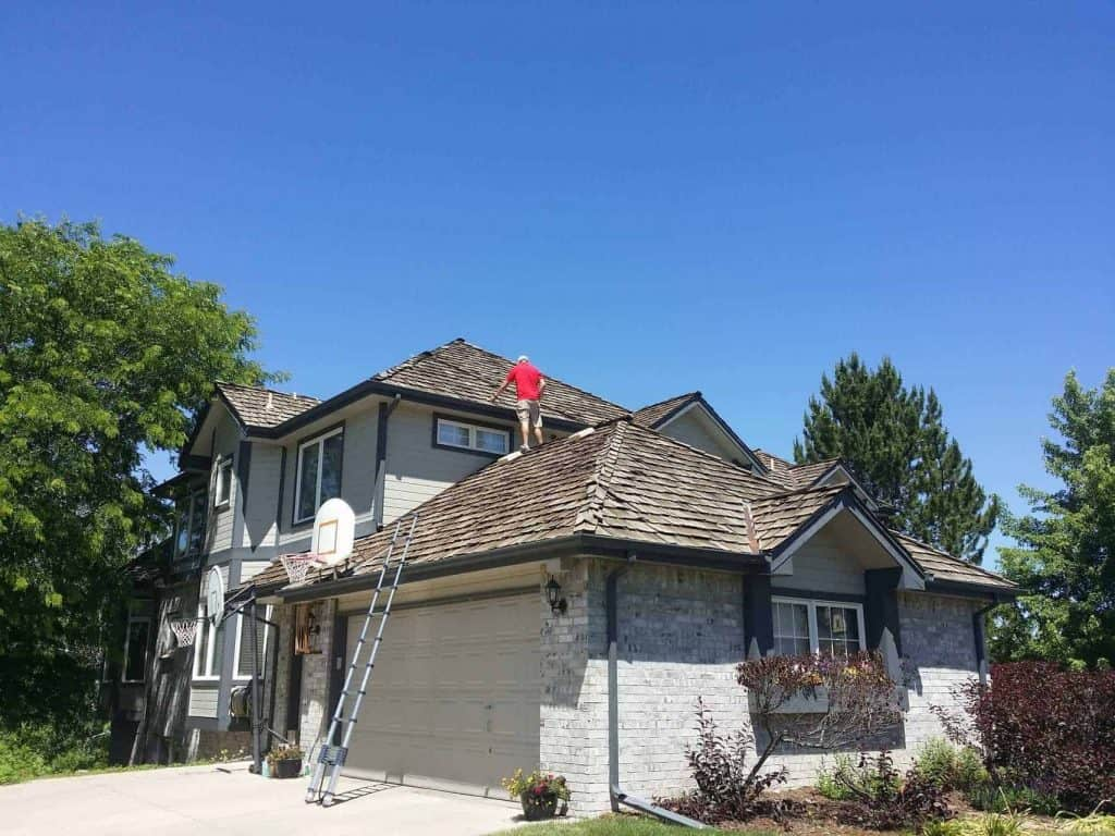 Wood Shake roof being inspected by Elite Roofing in Fort Collins.