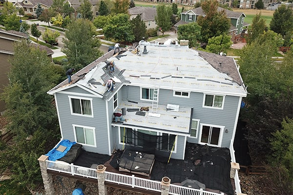 roof replacement by Elite Roofing.