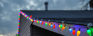 Christmas lights on a roof by Elite Roofing in Denver