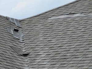 damaged residential roof
